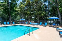 Common area amenities and features include lush landscaping, a dog park, and a community pool to help enjoy the sunshine. #SereneatRiverwood #FindYourHome #Amenities #Athens #GA #Apartments