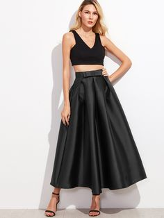 Black Bow Trim Pleated Long Skirt paired with a cropped black blouse.     us.SHEIN.com/Black-Bow-Trim-Pleated-Long-Skirt    