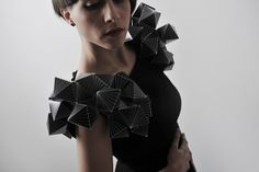 """The collection consists of five unique dresses handcrafted from a combination of textiles and paper. The main inspiration for the entire Collection is located in Platonic solids. Plato, the great Greek philosopher, studied what we now call """"Platonic solids"""". No one knows who first described the shapes of these bodies, perhaps early Pythagoreans, but some, including Euclid, say that it was a close friend of Plato's Theaetetus."""