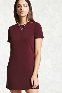 Style Deals - A stretch-knit mini shift dress featuring a round neckline and short sleeves.