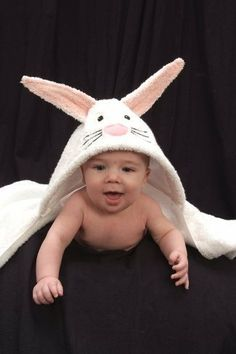 """Infant Hooded Towel - Bunny by Yikes Twins. $39.00. Usually ships in 5-7 business days54"""" x 30""""Fresh from the bath or swimming, wrap your little one in the Bunny Infant Hooded Towel for kids, perfect for your baby! We recommend personalization in pink (girl) or black (boy) for this special bath towel. With these fun animal hooded towels, bath time will be a cinch! No longer will your little one fight scrub a dub dub time; it will be embraced! Perfect for the pool..."""