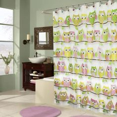 This adorable shower curtain features friendly owls in pastel shades of yellow, pink and green