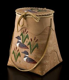 Birch Bark Berry Picking Basket (Loon design) by Carrie Kotchea, Dené artist. Medium: birch bark, spruce root, moose hide, and dyed porcupine quills. Shown at SPirit Wrestler Gallery, Vancouver, BC.