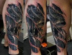 Biomechanics tattoo like the tearing detail work done here