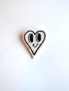 #Embroidered #heartbrooch with smily face in black and white #kitsch jewelry An Astrid Endeavor by #AnAstridEndeavor on Etsy