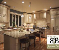 Traditional U-shaped Blue kitchen, cream cabinets
