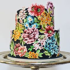 - This is a cake I have made for a wedding this week. The cake is covered with black fondant and then the flowers painted onto white gumpaste and cut out.