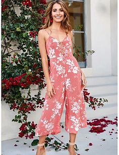 This floral jumpsuit has a beautiful boho print. It's a spaghetti strap design with V-neck and lace-up bodice. Pink Jumpsuit, Floral Jumpsuit, Blush Pink, Pink Blue, Type Of Pants, Fancy Pants, Different Fabrics, Wide Leg, Bodice