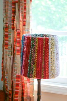 colorful rope lamp shade - fun way to use up extra rope/yarn, re-purpose a old lamp shade and add some textile texture to a room.