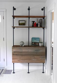 Pipe shelving, wonder if we can incorporate this idea with an entertainment center of sorts?
