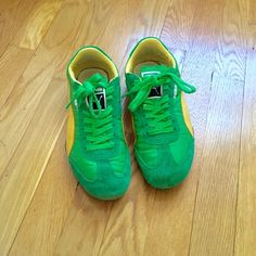 Puma sneakers Great condition. Unique green and yellow combo. Super comfy! These say size 7 but they got like a 6.5. Puma Shoes Sneakers
