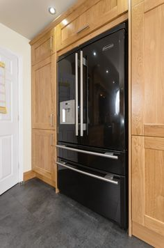 Here at Milligan & Jessop we can create any bespoke cabinet storage for you. So if you have a free standing american fridge freezer not to worry we can design around it. Making a feature that stands out in your kitchen.