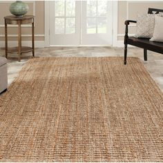 This hand-woven sisal rug will bring texture and depth to any room. Made from natural jute, this 8-foot square rug will look great at a beach house, in a living room, bedroom or office. A low pile makes this versatile rug easy to clean and maintain.