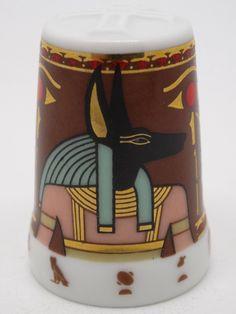 Dioses: Anubis. Porcelana. Colección: Im Glanz der  Pharaonen. Kunstarchiv. Alemania. Thimble-Dedal-Fingerhut.