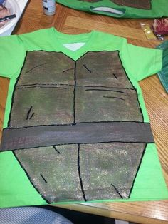 Hand painted turtle shirts All you need is: Green shirt Brown, gold & black puffy paint