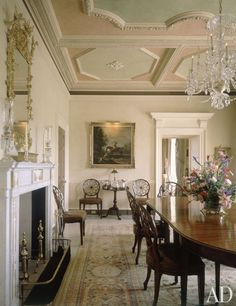 Furnished with Hepplewhite wheel-back chairs, Josephine Abercrombie's dining room at Pin Oak Stud in Woodford County, Kentucky is surmounted by an Adam-style ceiling painted in Jordan-almond pastels. The house's architect was British neoclassicist Quinlan Terry. (Architectural Digest - October 1989)