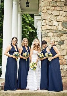 Navy bridesmaid dresses and vintage bouquets | Photo by Jag Studios