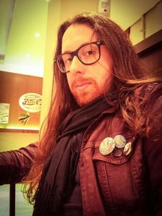 Writer longhair ginger glasses beard