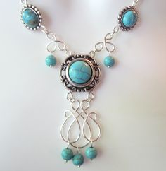 Turquoise Chandelier Necklace - Turquoise Slider Beads - Wire Wrapped Charm. $37.50, via Etsy.