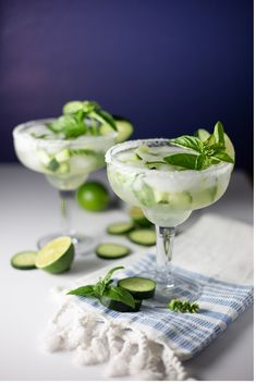 Cucumber Basil Margaritas are the perfect light drink for summer. Light, refreshing, and they require only 5 ingredients to make! Basil Cocktail, Cucumber Cocktail, Cucumber Drink, Cucumber Basil Martini Recipe, Healthy Alcoholic Drinks, Drinks Alcohol Recipes, Fun Drinks, Yummy Drinks, Alcoholic Drink Recipes