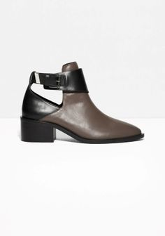 Chunky leather boots featuring an edgy cut-out, and a fresh silver-tone buckle to close ankle strap.