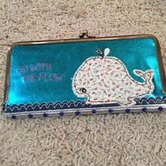"⭐FINAL SALE⭐️️Whale ""go with the flow"" wallet Natural Life whale ""Go with the flow"" wallet. Used once. ⭐️FINAL DAY TO PURCHASE THIS ITEM IS MAY 13th. LISTING WILL BE DELETED AT MIDNIGHT AND DONATED⭐️ Natural Life Bags Wallets"