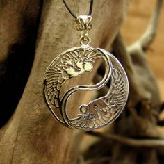 The Yin Yang Gold And Silver - Ancient Taoist symbol of unity and balance. The Yin Yang Pendant This is a version with one part in gold and one part in silver.    The Yin Yang is an ancient Asian philosophical outlook that sees polar opposites or opposite powers as powers that complete and define each other.  Opposite powers constitute a point of relationship and they complete and balance each other.