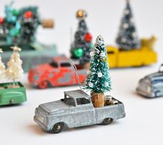 Vintage TootsieToy Truck, Silver Truck, pickup truck ornament with bottle brush tree, by Elizabeth Rosen by ElizabethRosenArt on Etsy https://www.etsy.com/listing/211532231/vintage-tootsietoy-truck-silver-truck