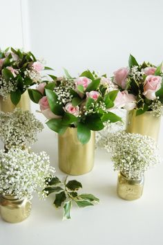Simple rose arrangements and baby's breath in jars
