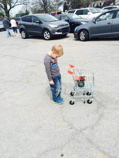 this kid wasn't allowed to take home his tiny shopping cart.