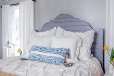 Cool and Inviting  Changes in the master bedroom were chiefly cosmetic. Joanna brightned up the space with new windows and French doors and chose a color palette of blues and grays, with yellow accents, to give the space a soft look and relaxing feel.