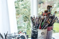 Brushes and paint - view out the window into nature - Michelle Miller Painting in her studio in Victoria BC - Abstract artist Brushes, Window, Victoria, Studio, Abstract, Day, Nature, Artist, Artwork