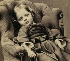A beautiful little girl, not postmortem, however it may well be a photo taken during serious illness, possibly shortly before death.