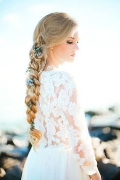 Romantic seaside bridal inspiration // Loose, thick braid embellished with flowers