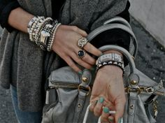 Piled-on bracelets.