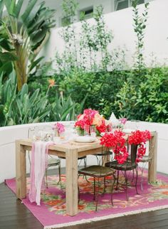 Rue Magazine Summer Wedding Inspiration: Bright and vibrant rug under Bride and Groom's table for accent
