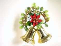 This vintage plastic bell, door hanging / Christmas wreath features a red flocked poinsettia flower backed with holly and red berry clusters