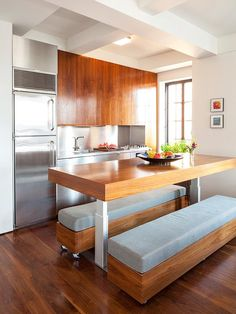 When designing a small kitchen area, such as in a casita or apartment over your garage or in your basement, consider building moveable benches that can easily roll out of the way at an open island.  Now you have a food prep area or a place to set up with food and beverages when entertaining in a small space.