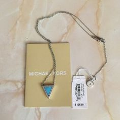 Authentic Michael Kors triangle necklace Silver tone with crystal embellishments turquoise triangle. Authentic Michael Kors necklace. NWT! Comes with original jewelry bag and everything else in pic. Michael Kors Jewelry Necklaces