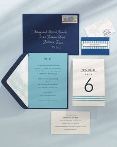 Stationery (The aqua-and-navy invitations and day-of details are modeled on shades of the sea.) - - Melanie and Giorgio's Mexican destination wedding at The Tides in Zihuatanejo.