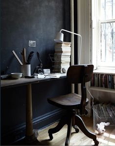 Note the bookshelf fitted under window and chalkboard back wall - lovely desk set up  -photo in themarionhousebook.com from prop stylist and store owner Hilary Robertson.