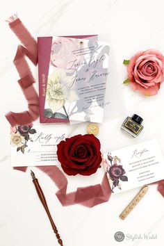 This digitally printed invitation with a moody floral pattern is held in place with a vellum overlay. It has a fine art feel and would be perfect at any time of year.