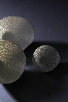 lightvessels. Perforated , high translucent porcelain by Linda Prüfer.