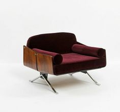 Jorge Zalszupin Attributed; Rosewood Veneer and Stainless Steel Lounge Chair, 1960s.