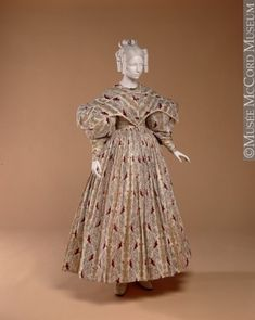 Dress About 1830-1835 Fibre: cotton (muslin, lining, embroidery); metal; Sewn (hand) M17935.1-2 © McCord Museum