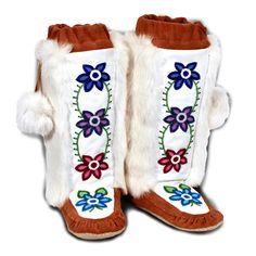 One year I made 4 pairs of mukluks with beadwork and fur for Christmas Gifts....These are selling for $1,200.00. Too bad a couple pairs that I gave as gifts got eaten by their dog! All those hours of beading......all those holes in my fingers from pressing a glovers needle through the deerskin..... All for what!? The dog enjoyed them!!