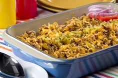 Cheeseburger Ramen Casserole | mrfood.com  •1 1/2	pounds ground beef  • 1 cup chopped onion  • 3 (3-ounce) packages beef-flavored ramen noodles  • 2 cups water  •3/4	cup ketchup  • 1 tablespoon yellow mustard  •1/4	cup sweet pickle relish  • 2 cups shredded Cheddar cheese