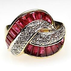 This bold estate cocktail ring from designer LeVian features natural rubies and diamonds and is crafted of solid 18k gold and is in very good condition.