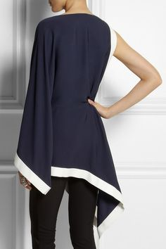 Assy, kimono sleeve, navy blouse with white satin trim, figure flattering and reminiscent of Chanel. Enjoy RUSHWORLD boards, UNPREDICTABLE WOMEN HAUTE COUTURE, WEDDING GOWN HOUND and MOOD BUSTERS FEEL BETTER NOW. Follow RUSHWORLD! We're on the hunt for everything you'll love!  #FashionTrend  #FashionWeek #WhatToWear NET-A-PORTER