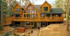 This luxury log home plan is a stunning example of how a log cabin design can be done right. With be ...